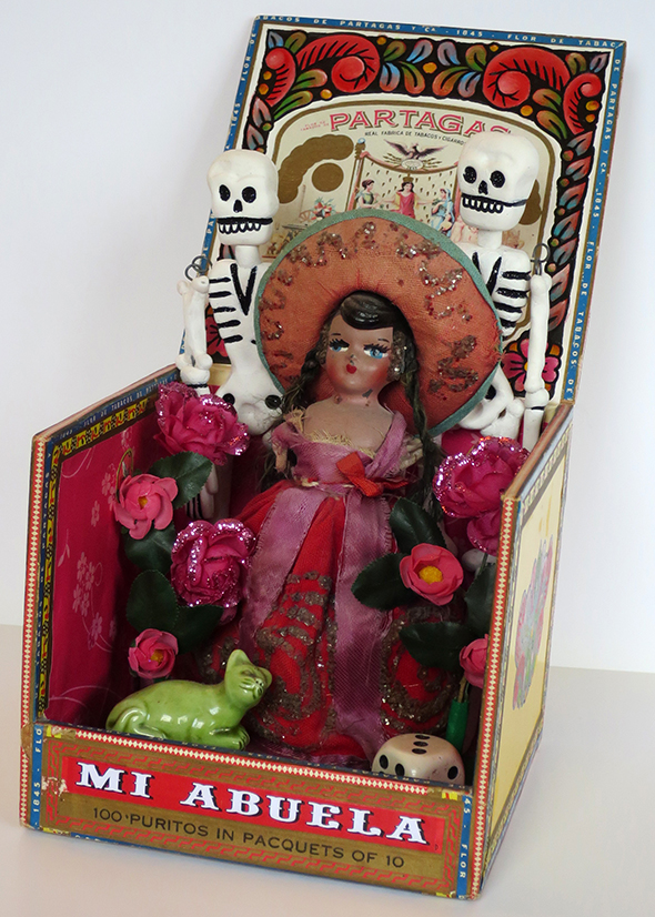 found objects installation mexican doll skeletons cigar box